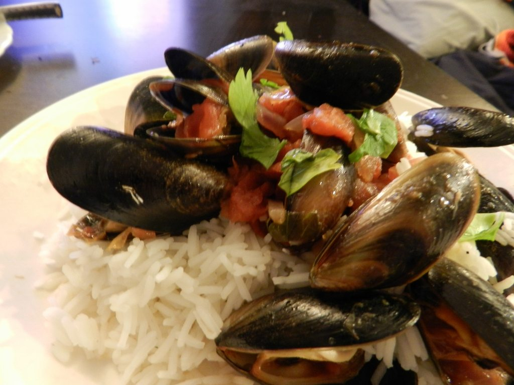 Mussels with red sauce and rice