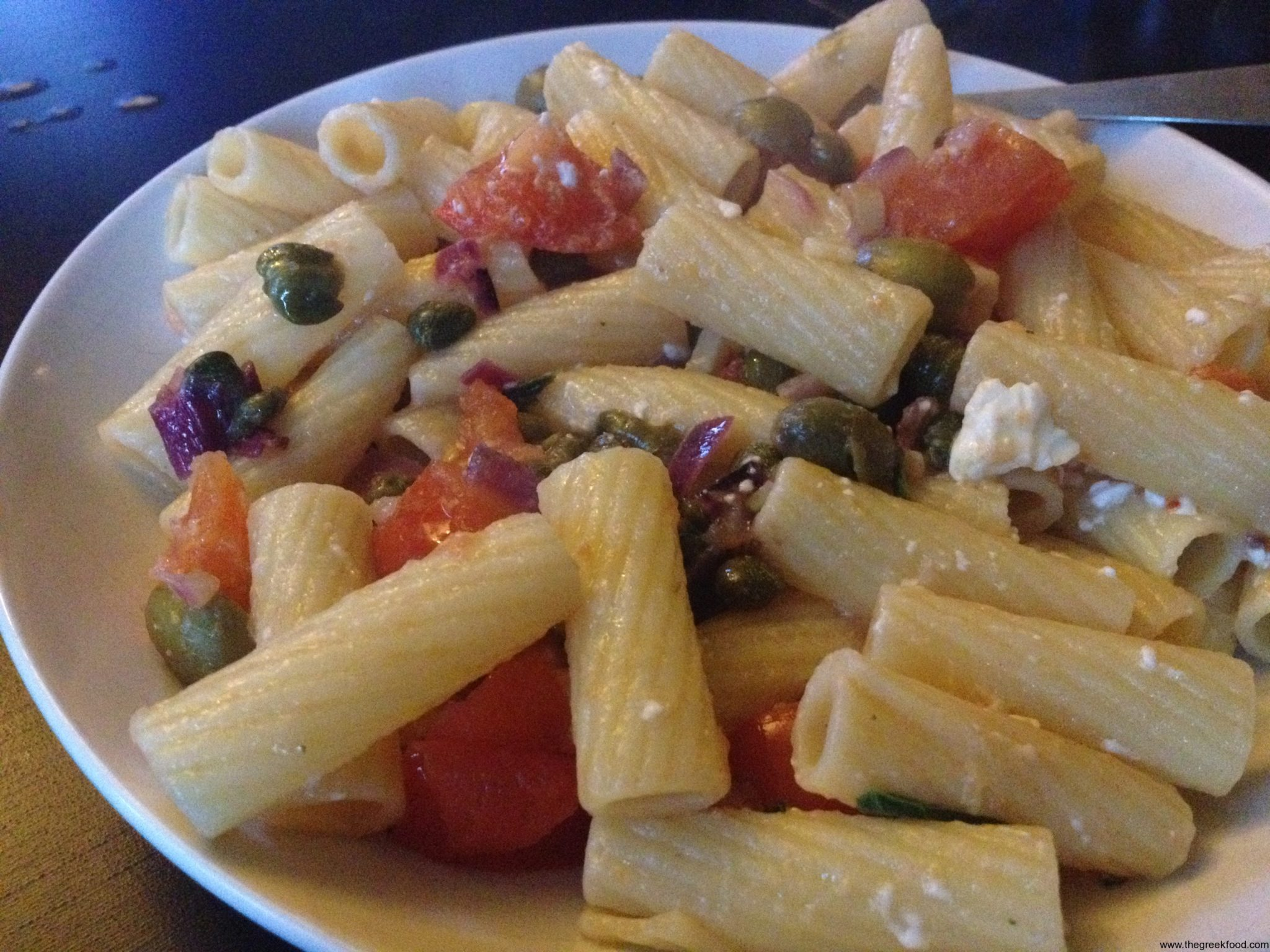 Pasta with feta cheese, tomato and capers