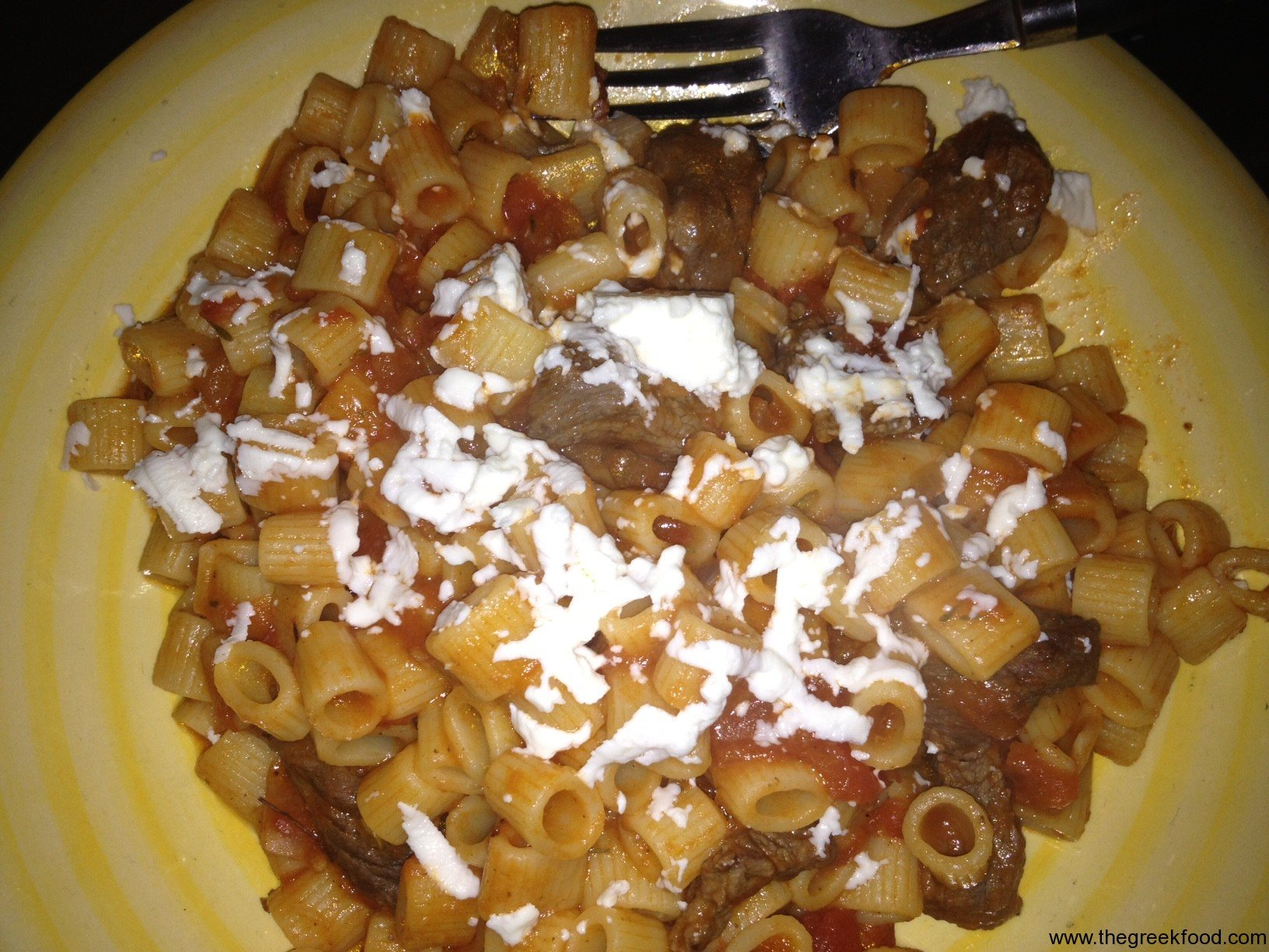 Beef stew with red sauce and pasta