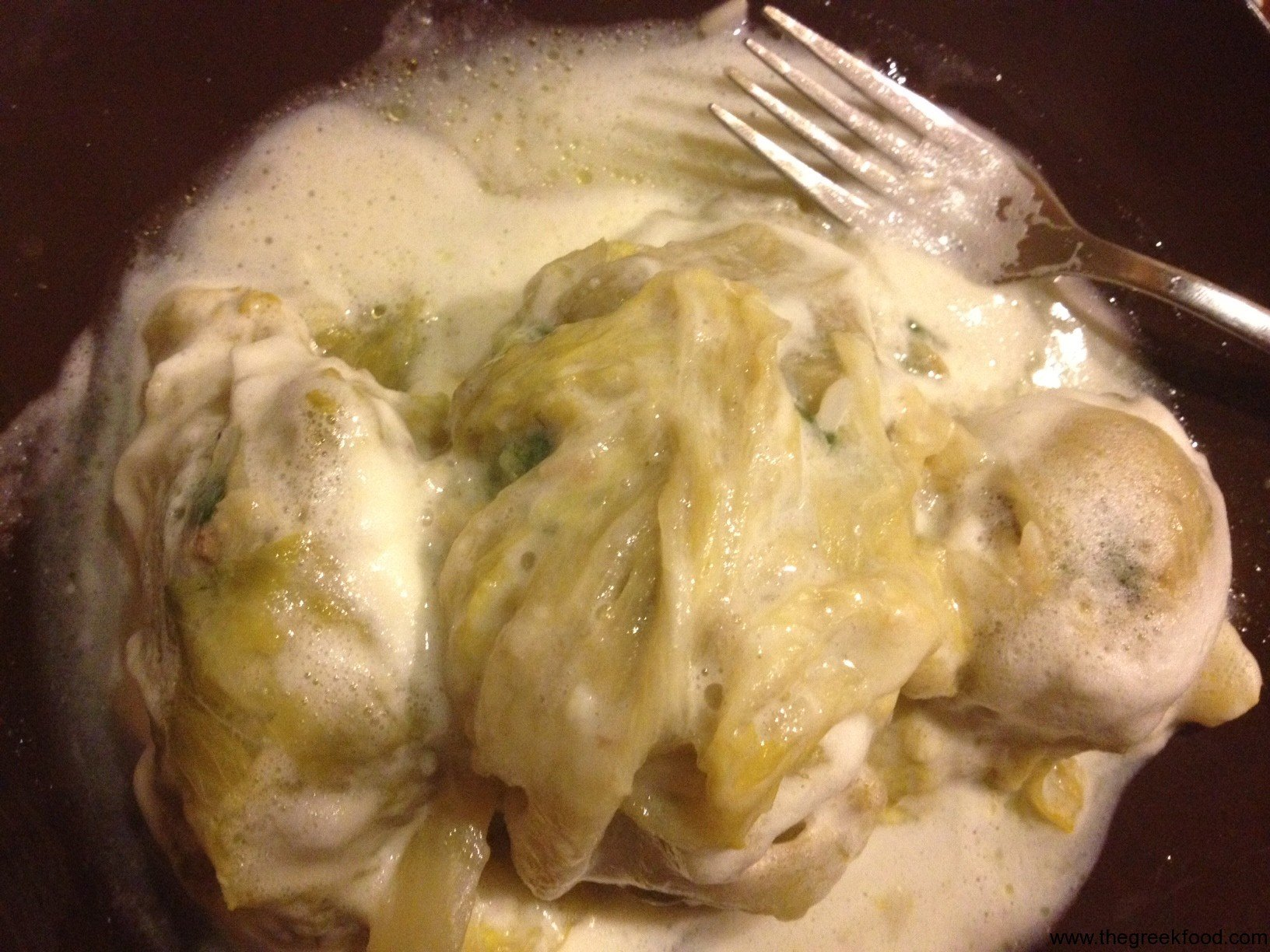 Making Lachanodolmades – stuffed cabbage leaves