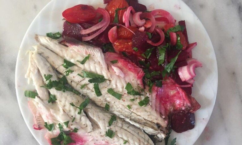 Cooking a bass fish with beetroots