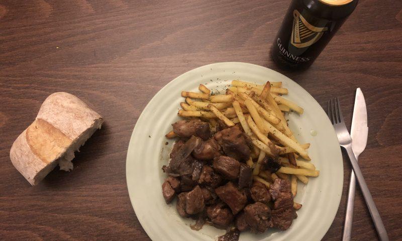 Pork with sausages in Black Beer
