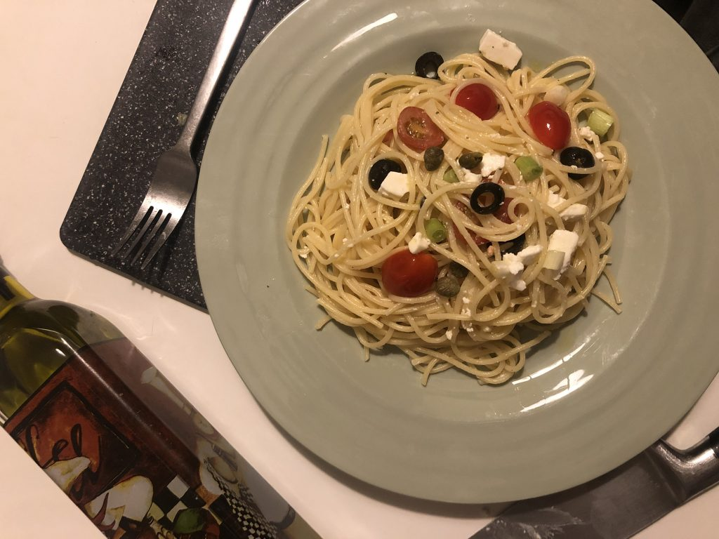 Pasta with feta cheese and tomato